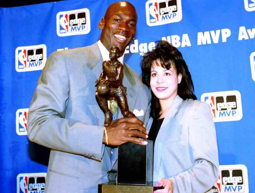 NBA star Michael Jordan with former wife Juanita Vanoy receiving award