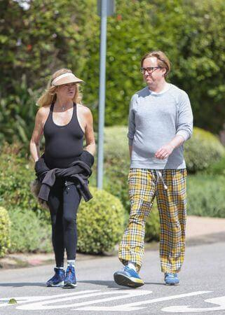 Golide Hawn and boston russell strolling in LA