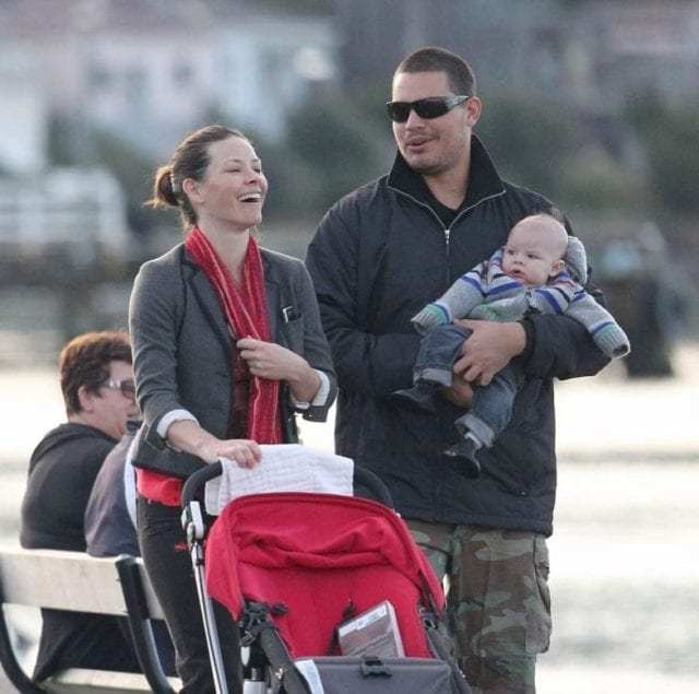 Norman Kali and Evangeline Lilly with their two kids going for a stroll